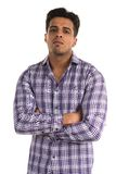 Hostile man. Handsome young Indian man with an aggressive expression stock photos