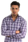 Hostile man. Handsome young Indian man with an aggressive expression royalty free stock photo