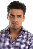 Hostile man. Handsome young Indian man with an aggressive expression stock image