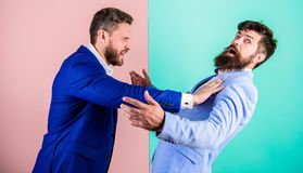 Hostile situation between opposing colleagues. Business partners competitors office colleagues tense faces conflict. Situation. Business competition and royalty free stock photos