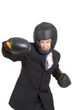 Hostile Takover. A businessman wearing boxing gear isolated on white stock images