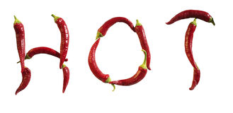 Hot. Spelling of the word hot appropriately using red hot pepper Royalty Free Stock Image