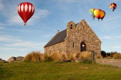 Hot air ballloon over Church Stock Photos
