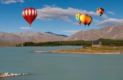Hot air ballloon over the Church. Hot air ballloon over Lake Tekapo, New Zealand Stock Images