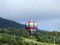 Hot Air Ballon. Landing in Hokkaido, Japan Royalty Free Stock Photo
