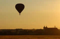 Hot air ballon. On the sky in sunset royalty free stock image