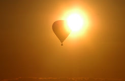 Hot air ballon. On the sky in sunset royalty free stock images