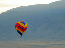 Hot Air Ballon against a Mountain Backdrop Stock Photos