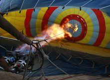 Hot air ballon burner heater wide. Members of the crew of a hot air ballon inflating the ballon before a demostration flight airshow in Palma de Mallorca stock images