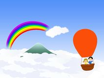 Hot air ballon going over the rainbow Royalty Free Stock Photography