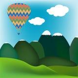 Hot air ballon over a mountain landscape. Hot colorful air ballon over a mountain landscape Royalty Free Stock Photo