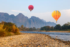 Hot air ballon over river in Vangvieng Royalty Free Stock Images