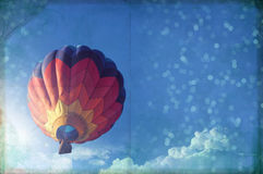 Hot air ballon paper texture, blue sky and light effect, vintage. Paper texture royalty free stock photography