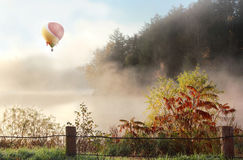 Hot air ballon. In the sky during sunrise royalty free stock photography