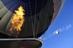Hot air ballon trip in cappadocia, turkey. Hot air ballon fly above cappadocia area. the fire is spraying into balloon Royalty Free Stock Images