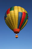 Hot air balloning. Hot air balloon against deep blue sky Stock Image