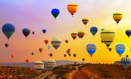 Hot air ballons flight. Tourists ride hot air ballons flight Balloon Festival panorama Royalty Free Stock Photos