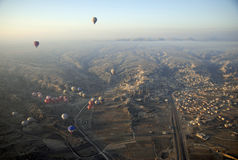 Hot Air Ballons flying on the sky of Cappadocia. Royalty Free Stock Photo