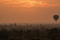 Hot air ballons over pagodas in sunrise at Bagan Royalty Free Stock Images