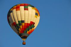 Hot Air Balloon 1. Colorful hot air balloon against a bright blue sky stock image
