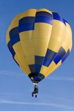 Hot Air Balloon. Blue and yellow hot air balloon on a sunny morning Royalty Free Stock Photo