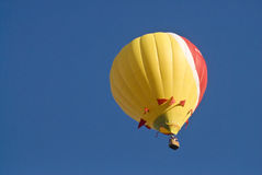 Hot air balloon. Flying up in a clear blue sky Royalty Free Stock Photography