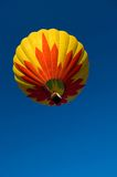 Hot Air Balloon. Beautiful hot air balloon against dark blue sky with basket Royalty Free Stock Photography