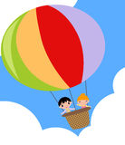 Hot air balloon. Illustration of hot air balloon with two kids-boy and girl Royalty Free Stock Image