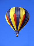 Hot Air Balloon. Colorful hot air balloon against brilliant blue sky Stock Images