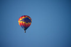 Hot Air Balloon. A Hot Air Balloon soars in the blue sky Stock Photography