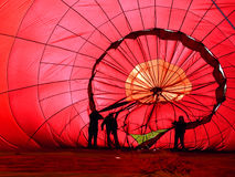 Hot Air Balloon. View of the inside of a red hot air balloon being infalated Stock Photos