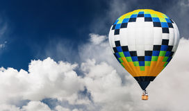 Hot air balloon. Flying in blue sky Stock Images