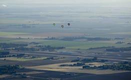 Hot Air Balloon. Beautiful hot air balloons against green fields Stock Photo