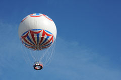 Hot Air Balloon. Photograph of a hot air balloon flyying in the sky offset to leave room for copy Stock Photos