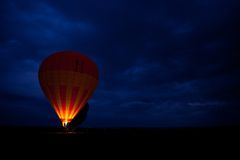 Hot Air Balloon. Preparing to take flight early in the morning. Balloon Safari is one of the most popular ' add-on ' option with tourists on Safari or Beach Stock Photography