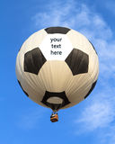 Hot air balloon. In shape of soccer ball with text space Stock Photography
