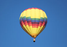 Hot Air Balloon. Colorful hot air balloon against clear blue sky Stock Photo