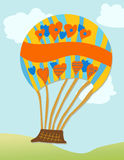 Hot Air Balloon. Cartoon hot air balloon in brilliant colors with space for text Stock Photography