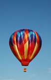 Hot Air Balloon. Colorful hot air balloon floating in the blue summer sky royalty free stock photography
