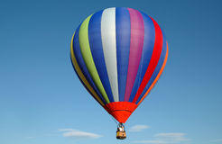 Hot Air Balloon. Colorful hot air balloon floating in the blue summer sky stock images