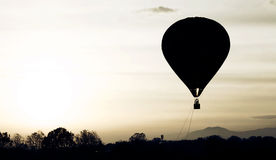 A hot air balloon. Against in sunset royalty free stock image