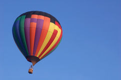Hot air balloon. A hot air balloon floating in a clear sky Stock Images