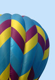 Hot Air Balloon. Closeup of colorful hot air balloon against the blue summer sky stock photography