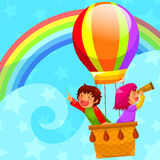 Hot air balloon. Happy kids flying in a hot air balloon Royalty Free Stock Photography