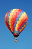 Hot Air Balloon. A multi-colored hot air balloon flying in the sky royalty free stock photo