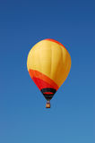 Hot Air Balloon. A multi-colored hot air balloon flying in the sky royalty free stock photography