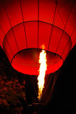 Hot air balloon. Glowing in the night stock photography