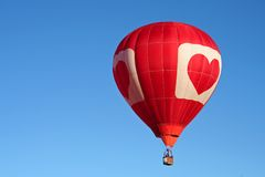 Hot air balloon. Colorful hot air balloon against a clear blue sky Stock Image