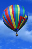 Hot air balloon. Colorful striped hot air balloon against a blue sky Royalty Free Stock Photography