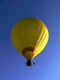 Hot Air Balloon. Yellow balloon on the blue sky royalty free stock image